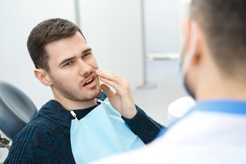 Man in dental chair with toothache