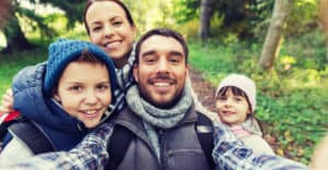 Hiking and smiling family