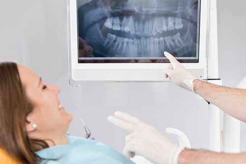woman getting dental x-rays